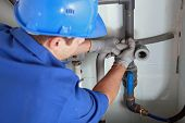 foto of inlet  - Plumber installing pipes - JPG