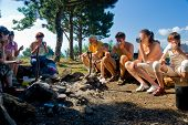 foto of boy scout  - Hikers have breakfast in camp in mountains - JPG
