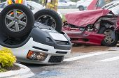stock photo of intersection  - Rollover Vehicle Accident at Busy Intersection With Emergency Personnel on scene - JPG