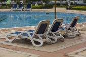 picture of snowbird  - Lounge chairs on a pool inside a hotel - JPG