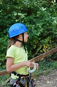 image of parkour  - Preteen girl is wearing on the outfit for rope parkour - JPG
