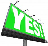 The word Yes on a green outdoor advertising billboard sign to communicate approval, positive answer,