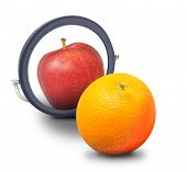 stock photo of envy  - An orange fruit is looking at a mirror and wants to be an apple on a white isolated background - JPG