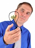 Business Man Holding Idea Light Bulb