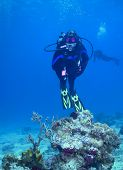 Woman scuba diver on reef in Cozumel