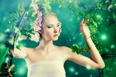 picture of loach  - Beautiful young woman standing under an arch of flowers and overgrown loach - JPG