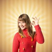 Young Woman Making Ok Sign Over Yellow Background