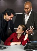 pic of immoral  - businessmen harassing a woman at the workplace - JPG
