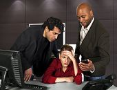 foto of creeping  - businessmen harassing a woman at the workplace - JPG