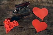 Creative love concept, ironing wrinkled hearts on a vintage background.