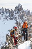 Alpinists climbing ferrata La torre di Toblin (2.617 m), Dolomites, Italy, Europe