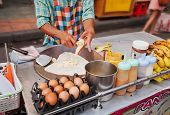 Cooking Thai Banana Pancake On The Street