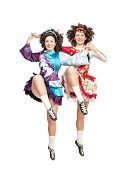 Two Young Women In Irish Dance Dress Dancing Isolated