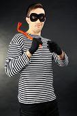 Thief on dark background