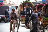 KATHMANDU, NEPAL - NOV 28: Unidentified nepali rickshaw in historic center of city, Nov 28, 2013 in Kathmandu, Nepal. Largest city of Nepal, its historic center, a population of over 1 million people.