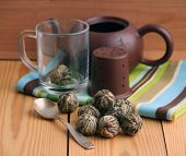 Chinese Green Tea Balls With Jasmine Flowers, Tea Cup And Pot