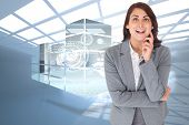 Smiling thoughtful businesswoman against room with holographic cloud