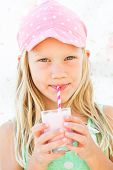 Young Girl Drinking Smoothie