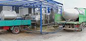picture of tank truck  - Unloading raw milk from trucks in dairy factory - JPG