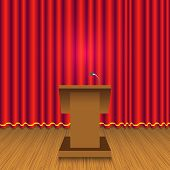 pic of curtains stage  - Podium infront of red curtain wall on stage - JPG