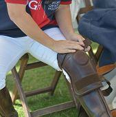 TSELEEVO, MOSCOW REGION, RUSSIA - JULY 26, 2014: Jacqueline Hooper of British Schools team wearing the kneepad during the British Polo Day. Tseleevo Golf & Polo Club hosts the event for the 2nd time