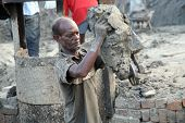 SARBERIA,INDIA, JANUARY 14: Brick field. Laborer carrying deposited soil for making raw brick. on Ja