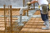 pic of engineering construction  - Workers pouring concrete on big floor construction on the construction site with motion blur - JPG