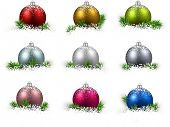 Colorful set of realistic christmas balls on snow with fir branches. Vector illustration.