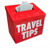 Travel Tips words on a red suggestion box collecting your tips, advice, feedback and reviews or othe