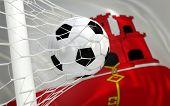 Flag Of Gibraltar And Soccer Ball In Goal Net