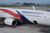 KUCHING - MAY 06: docked Boeing 737 of Malaysian Airline on May 06, 2014 in Kuching, Malaysia. Malaysian Airline System is a major airline operating flights from Kuala Lumpur International Airport