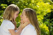 Mother And Daughter Sharing A Moment Together Outdoors