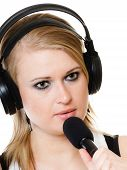 Girl Singer Musician With Headphones Singing To Microphone