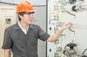 Chemical Engineer Checking Part Of Machine In Factory