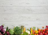 image of farmers  - studio photography of different fruits and vegetables on wooden table - JPG