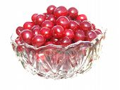Glass Vase With Clear Glass Filled With Red Cherries Isolated On White Background.