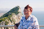Senior Woman Tourist At The Rock Of Gibraltar