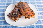 Barbecue Ribs On White Plate