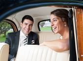 Bride And Groom Inside A Classic Car
