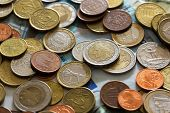 Lot of coins from different countries. Background and texture