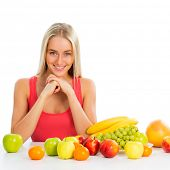 Smiling pretty woman with fruits