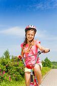 Teenage girl ride bicycle