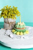 picture of sugar paste  - Tasty cupcake on table - JPG
