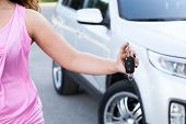 Unrecognizable Woman Showing Ignition Key In Hand Near Own New Car