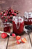 foto of jar jelly  - Berries jam in glass jar on table - JPG
