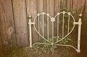 Old heart-shaped white wrought iron headboard