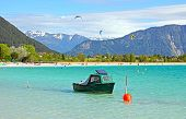 Lake Achensee With Fishing Boat And Kite Surfers
