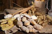 Bread sticks on sackcloth on wooden background