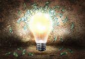 Conceptual image of light bulb and dollar banknotes