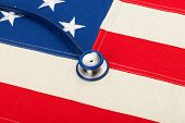 Usa Flag With Stethoscope Over It - Studio Shoot
